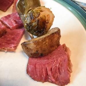 A bite of Irish perfection-- corned beef, roasted potatoes, and a brussel sprout.